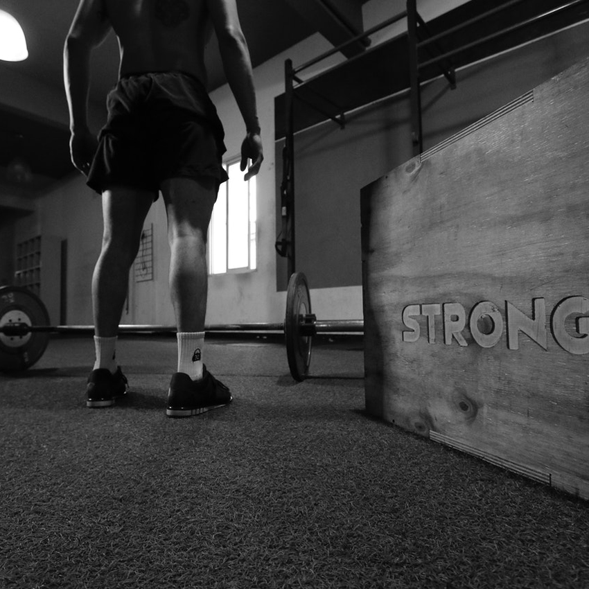 Modern colored sun glasses with black frame on white background